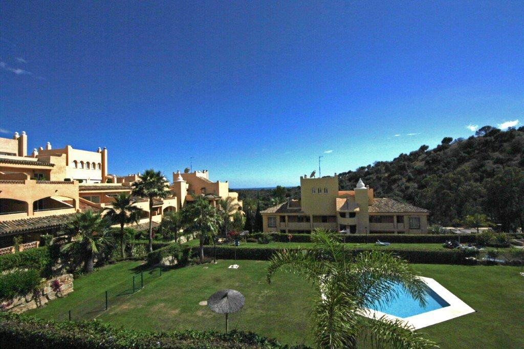 Best located apartment in the well cared complex in Elviria surrounded by colorful communal gardens ,Spain