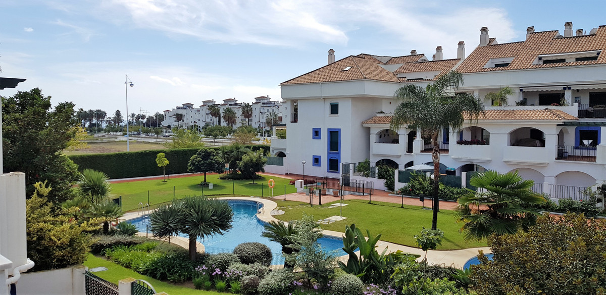 This large townhouse has a fantastic location only 300m from the beach and within walking distance t,Spain