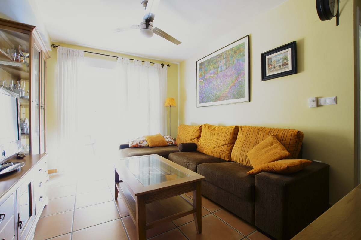 Apartment i n beachfront in Torrox Costa. Fully furnished and equipped with a bedroom with built-in ,Spain