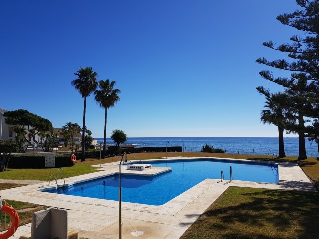 Beachside one bedroom apartment with a private terrace! Great location in this frontline beach commu,Spain