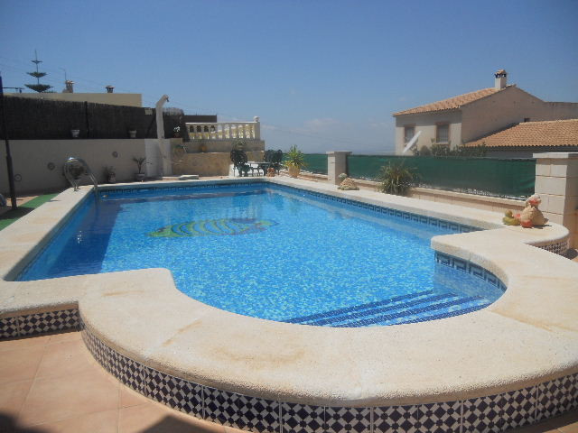 A corner villa in perfect condition with private swimming pool and within easy walking distance from, Spain