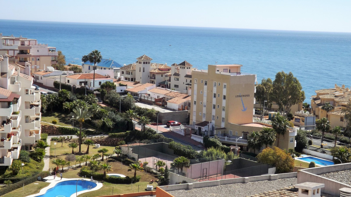 Lovely bright north facing two bedroom corner duplex apartment with amazing sea views situated in a ,Spain