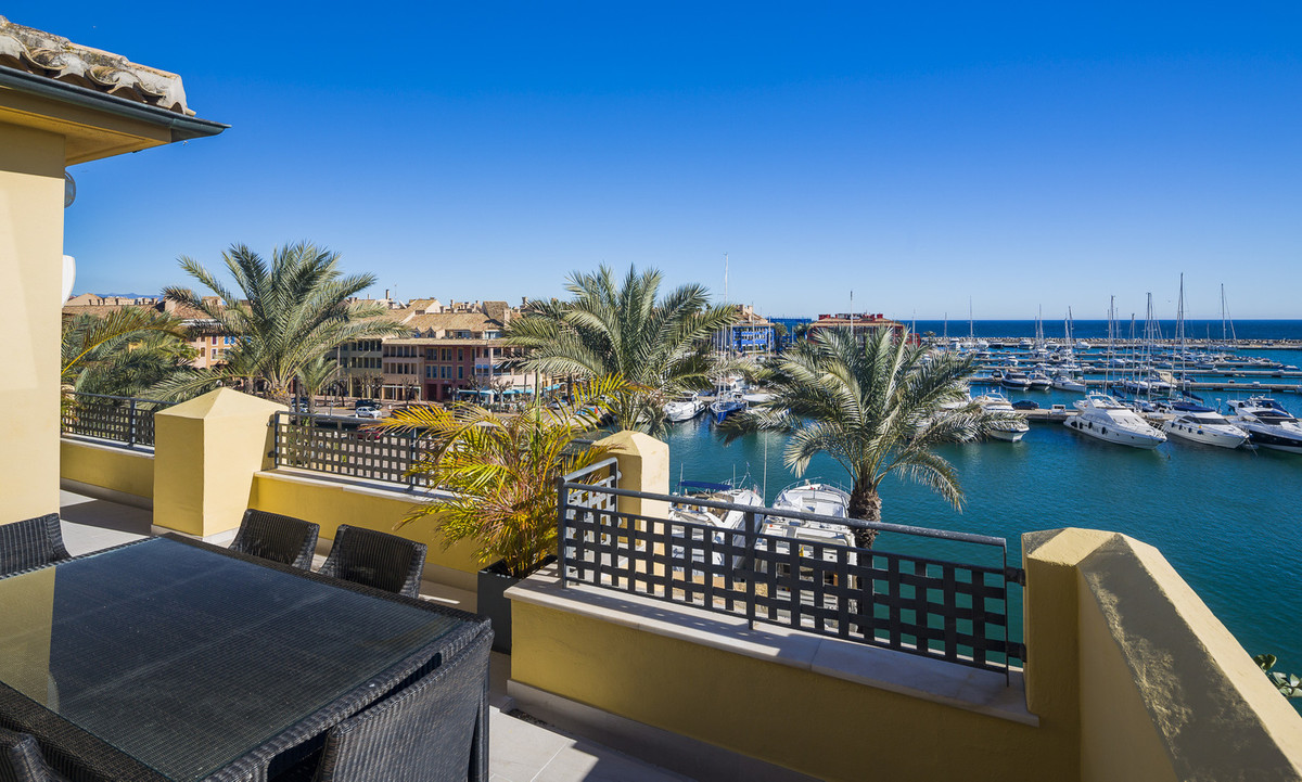 Beautiful luxurious duplex penthouse with unobstructed views over the marina, its yachts, and the se Spain