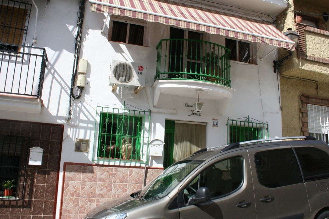 The house benefits from a front and rear access and on the ground floor there is a fully-fitted kitc,Spain