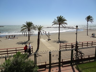 A huge 5 bed beachfront duplex garden apartment with wonderful sea views right on the beachfront in ,Spain