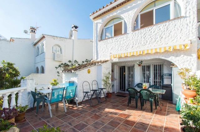 Beautiful and renovated corner townhouse with large patio located in an Andalusian style urbanizatio, Spain