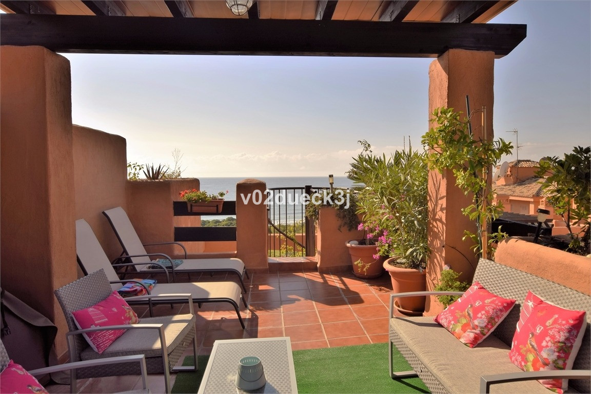 Seafront penthouse with wonderful sea views. Three bedrooms with roof terrace and Jacuzzi. A complex, Spain