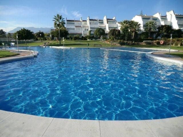 Corner garden apartment located in a beautiful gated first line beach complex. It offers large commu,Spain
