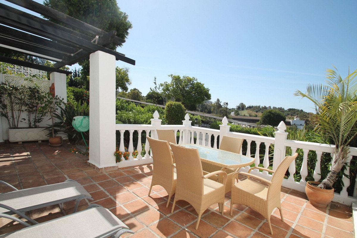 South facing partially refurbished two bedroom ground floor apartment in the gated community of Club,Spain