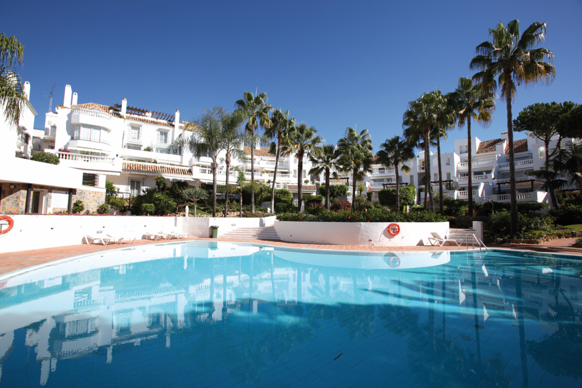 Within the sought-after White Pearl Beach I, this garden apartment a few steps only from a sandy bea,Spain