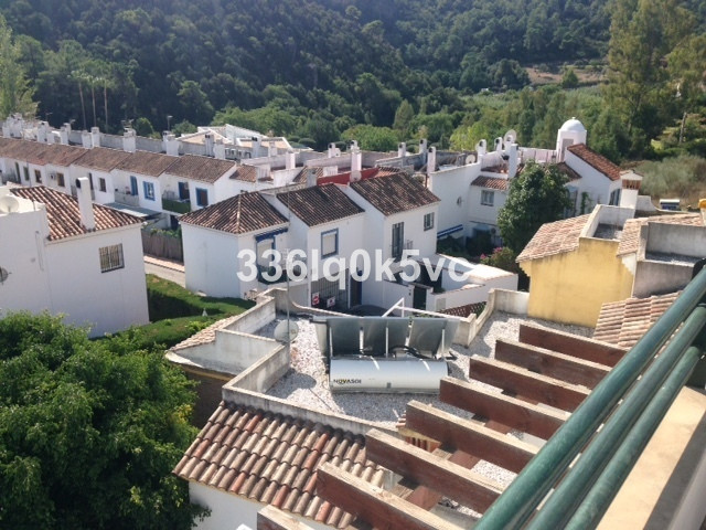 Perfectly maintained corner townhouse on a quiet urbanization in Benahavis center. This townhouse ha, Spain
