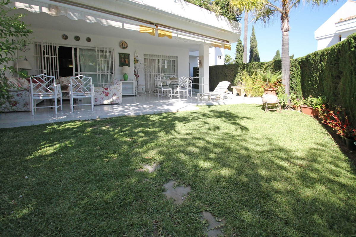 South West facing three bedroom corner ground floor apartment nestled in a gated complex in Guadalmi, Spain