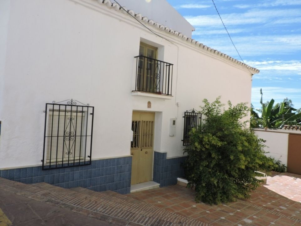 A lovely village house situated in the heart of Periana. This property is full of rustic charm and c,Spain