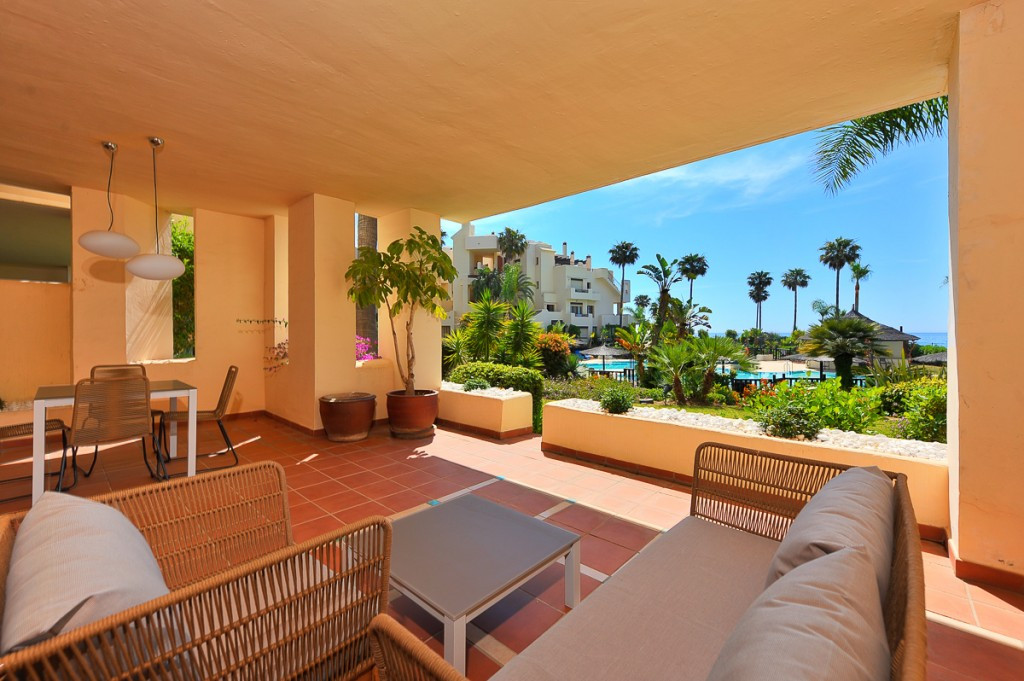 This beautiful frontline beach ground floor apartment is situated on a luxury development on the New,Spain