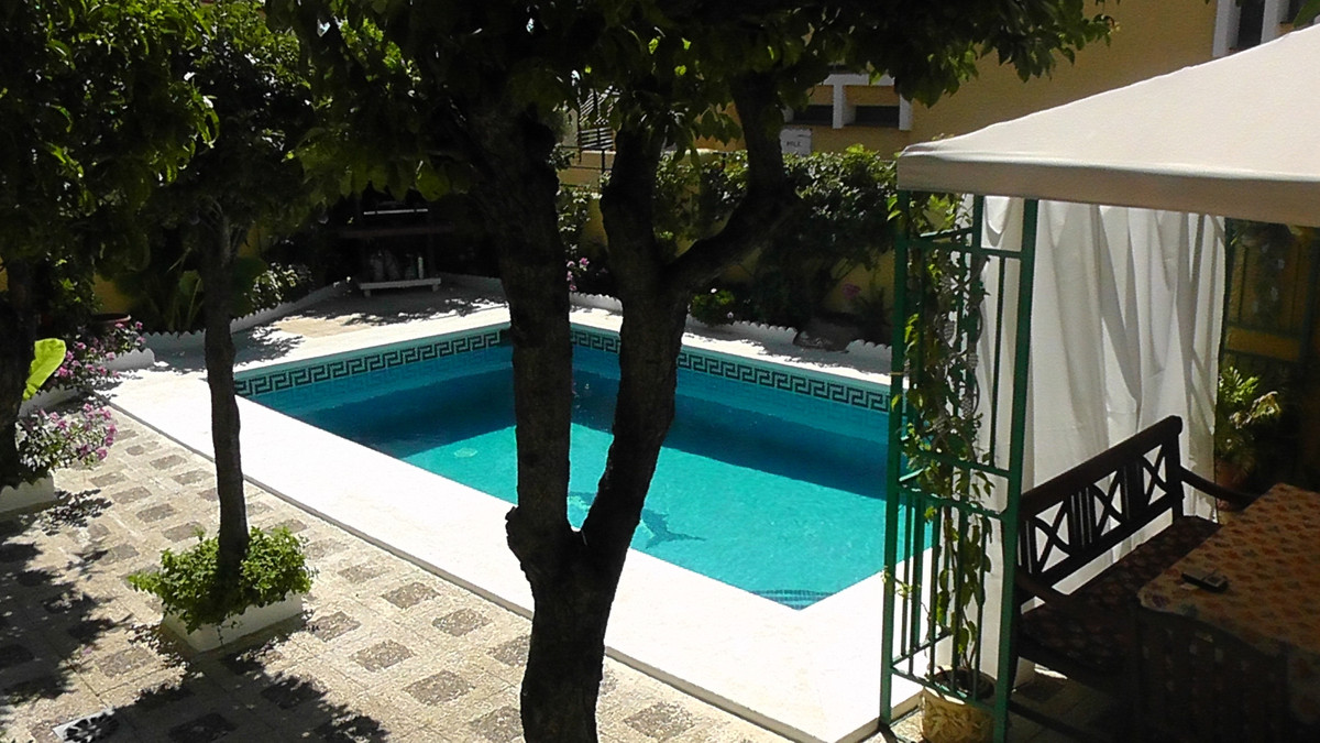 Extensive townhouse in Benalmadena Costa with 250m2 garden and own fruit trees. Four bedrooms, two b, Spain