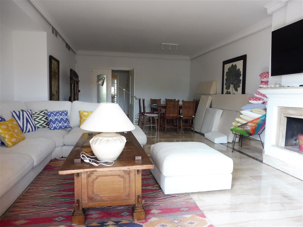 Large and spacious duplex penthouse with four en- suite bedrooms and two terraces set in a tropical , Spain