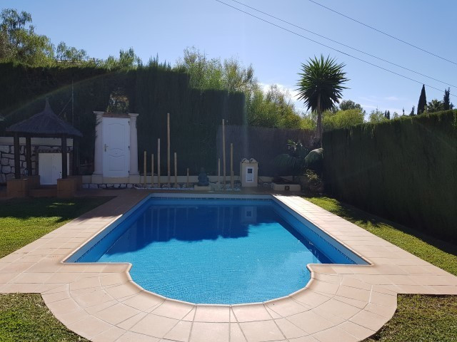 Villa for sale and for rent! Located close to the beach in La Cala, this villa offers a total of sev,Spain