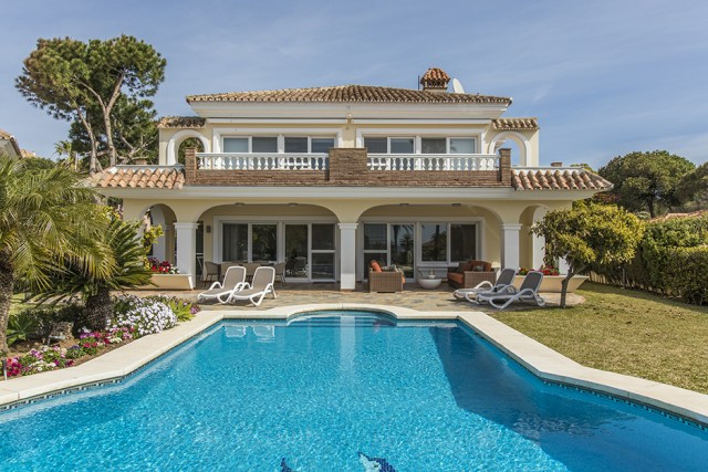 This fantastic south facing villa is located within 100m of the beach in one of the most sought-afte, Spain