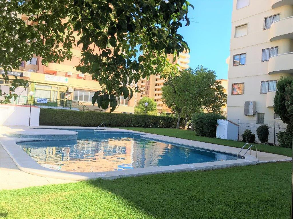 Bright apartment in gated community with porter at reception, in the center of Los Boliches, a stone,Spain