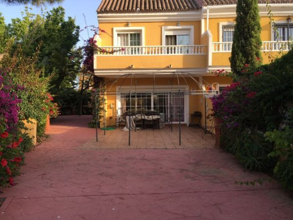 Detached house with garden in semidetached corner. It has three floors. Kitchen and living room on t,Spain