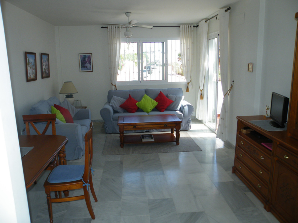 A lovely well maintained 2 bedroom 2 bathroom raised ground floor apartment with open views. Lounge , Spain