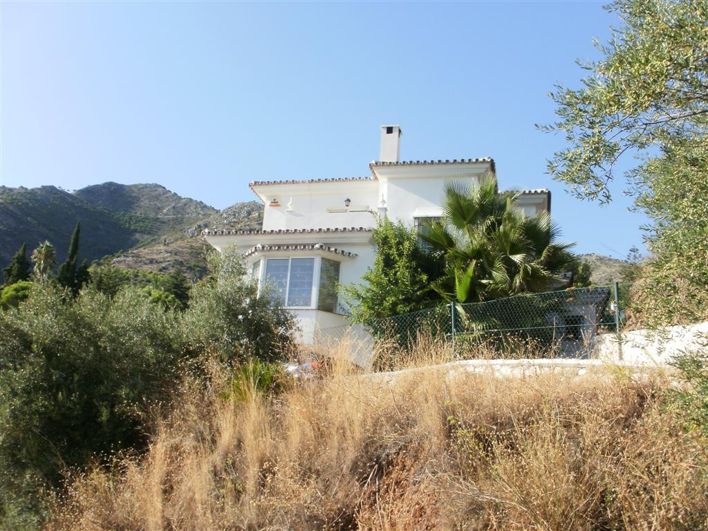 An immaculate south facing villa close to Mijas Pueblo. The property is entered via a gate driveway , Spain