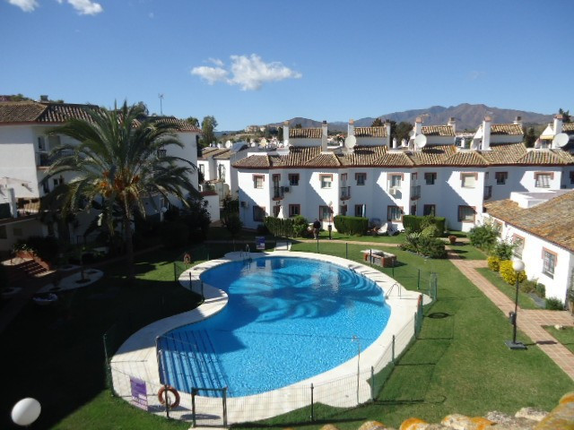 This 3 bedroom 2 bathroom Town House is located in a secure community near the Mijas Golf Course.  T,Spain