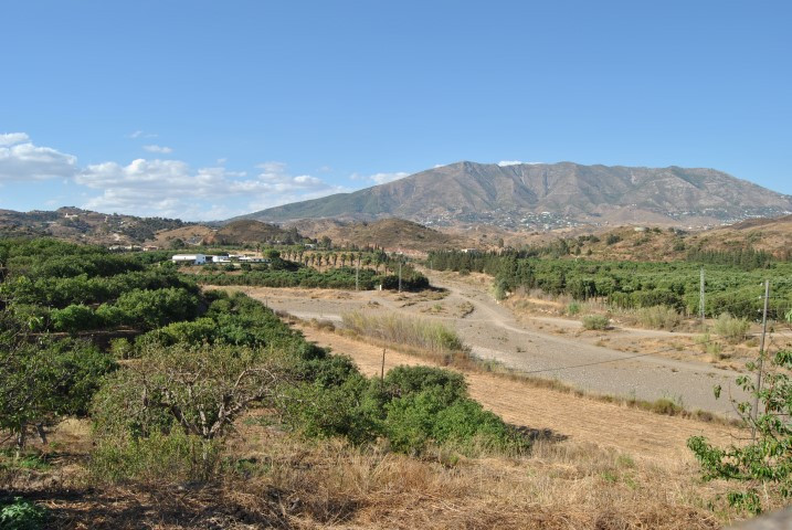 Offers welcome !  Huge plot with two houses, swimming pool and large warehouse with stables in Entre, Spain
