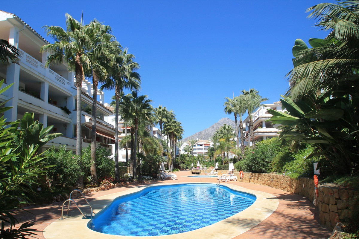 BEACHFRONT - Immaculate South-East facing two bedroom garden apartment perfectly located in Las Cana, Spain