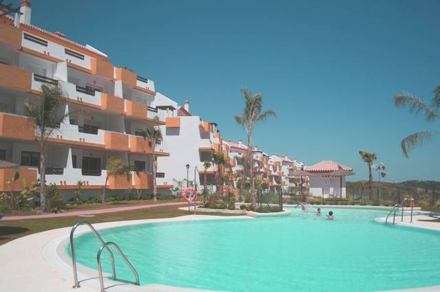 This south west facing 2nd floor apartment has panoramic views to the sea, golf course and the mount, Spain