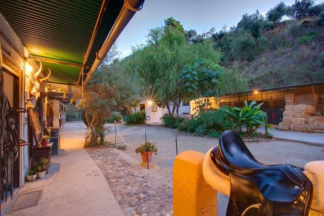 This stunning equestrian property is currently used as a successful business comprises of 22 horsebo,Spain