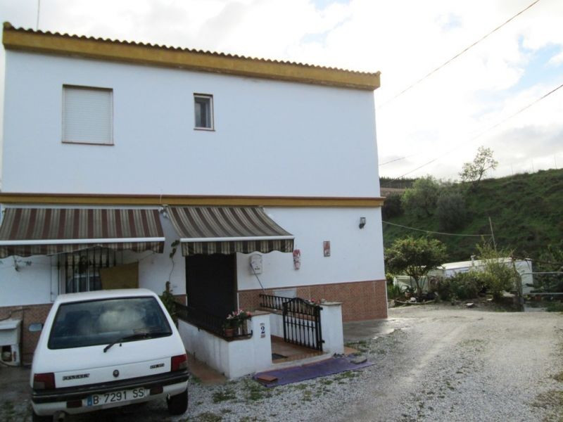 This house is situated just off the main road into the charming village of Benamocarra, and is withi,Spain