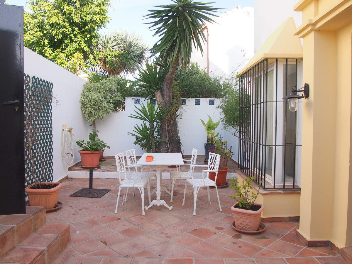 This three level townhouse is situated within a 15-unit community in Guadalmina Alta, close to Guada, Spain