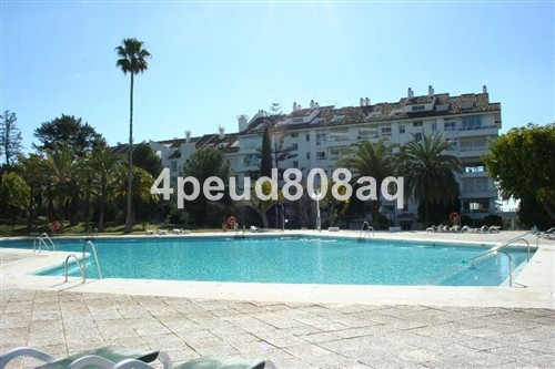 180m2 Built ground floor apartment with access onto the communal garden from its covered terrace wit, Spain