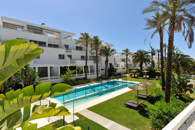 This top quality apartment is located in a totally secure and gated urbanisation just minutes from t,Spain