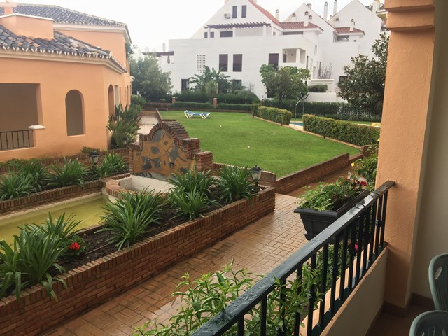 This is a beautiful ground floor apartment located inside a gated and well maintained complex, in th,Spain