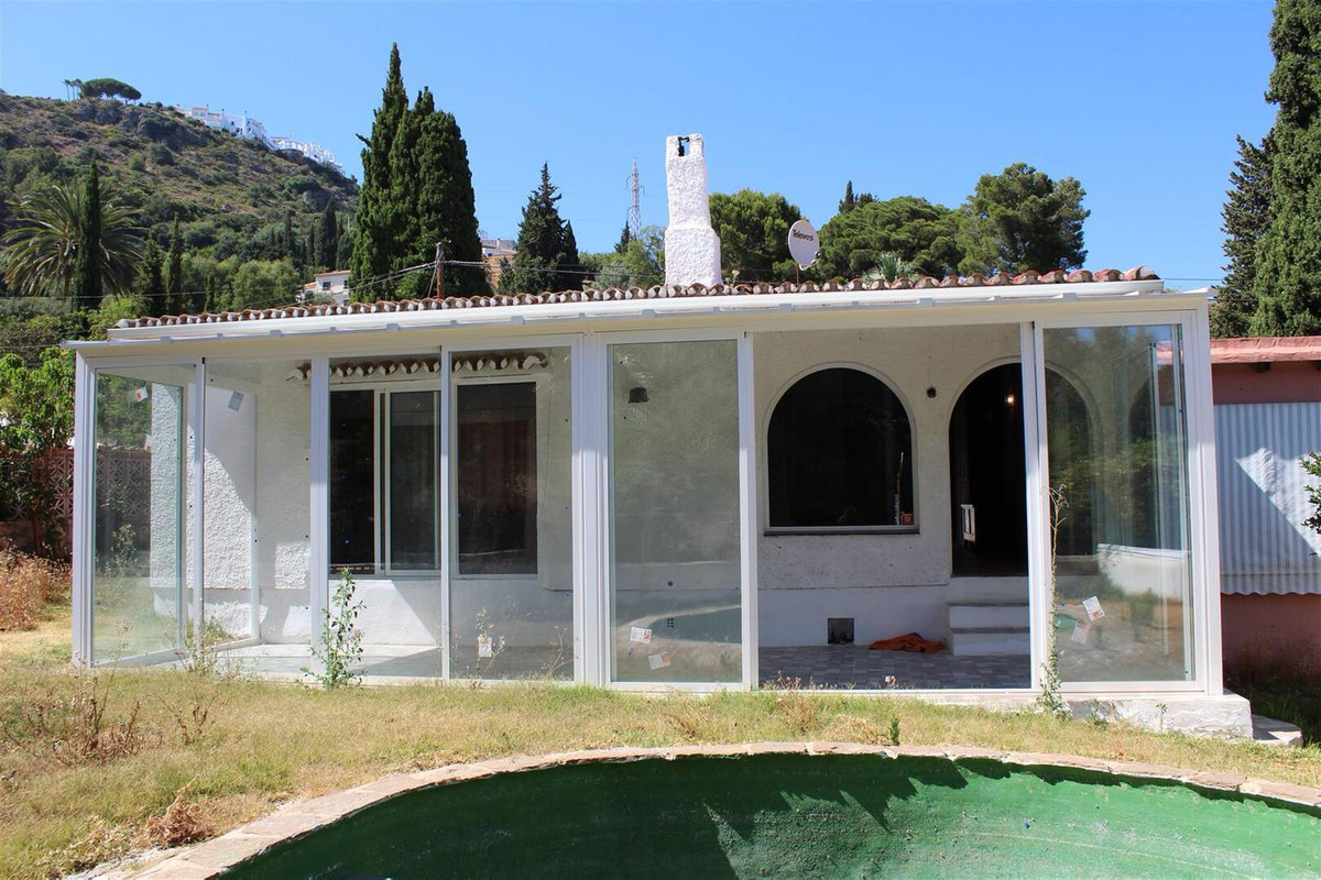 ***EXCLUSIVE NEW LISTING IN BENALMADENA***  Stunning rustic detached villa. Nestled under the beauti,Spain