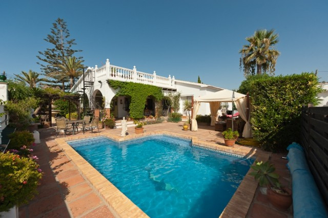 Fabulous villa located in a very quiet urbanization in La Cala. Property is situated in an elevated ,Spain