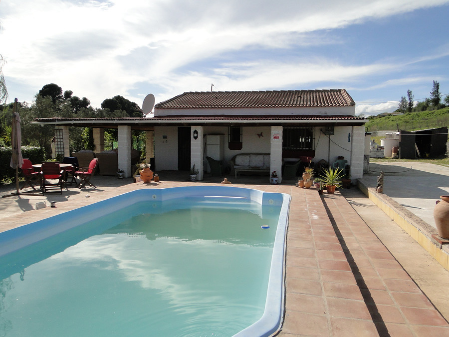 Finca with wonderful views a short distance to Coin.  A driveway entrance with electric gates leads , Spain