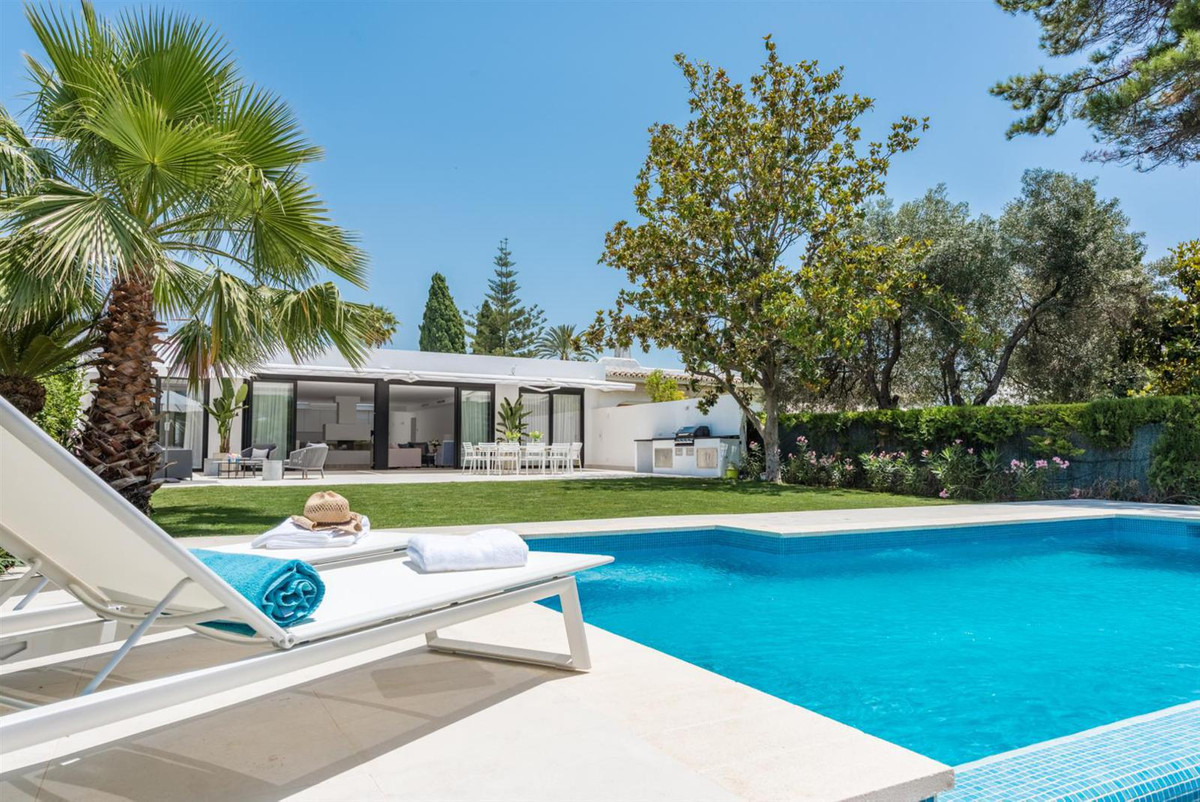 Well planned and totally reformed semi-detached house in one level with a big plot and a infinity-po,Spain