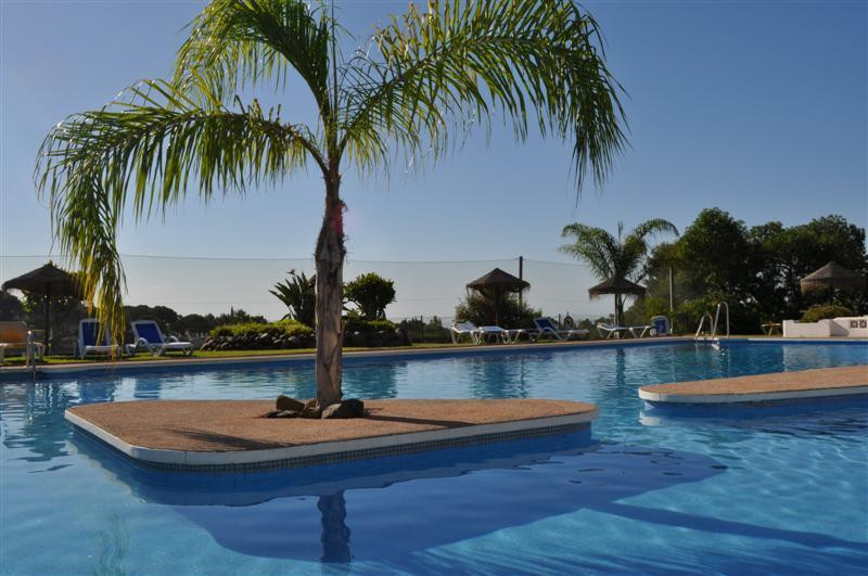 """Lovely apartment with views to the swimming pool and garden. Ideal for golf lovers and people , Spain"