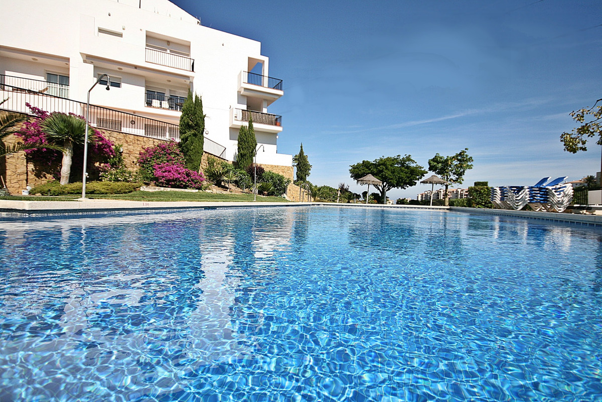 Spacious elevated ground-floor apartment with partial sea, mountain & pool views. This beautiful, Spain