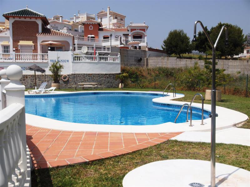 Beautiful townhouse in Torrox with wonderful sea views. The House has a living/dining room with much,Spain