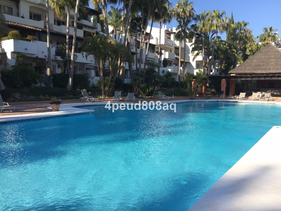 West facing partly furnished 1st floor corner flat located within Marina de Puente Romano with wrap ,Spain