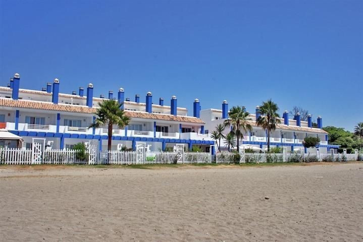 Amazing front line beach townhouse located in El Saladillo beach, close to all local amenities. The , Spain