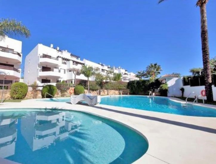 This penthouse, completely renovated, 2 bedroom, with southfacing terrace is situated on the beachsiSpain