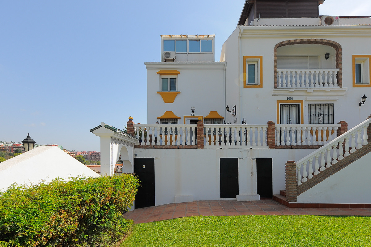 Fabulous corner townhouse just a couple of minutes walk from the sought after beach of Carvajal in B, Spain