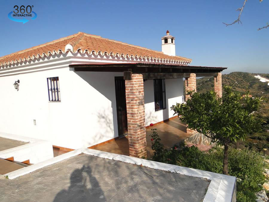 Charming finca with superb panoramic country views.  On two levels, the ground floor has a living ro,Spain