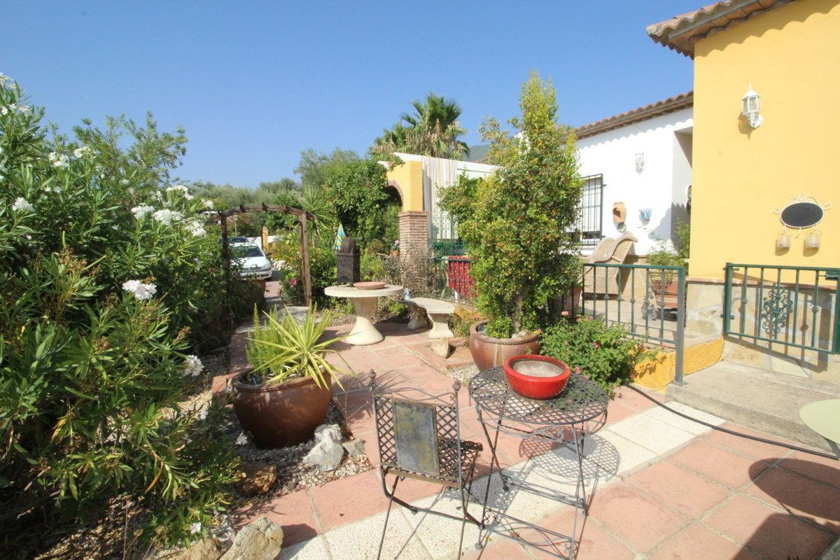 Beautiful Villa in Alcaucin, consists of a spacious living room with fireplace, kitchen with exit to,Spain
