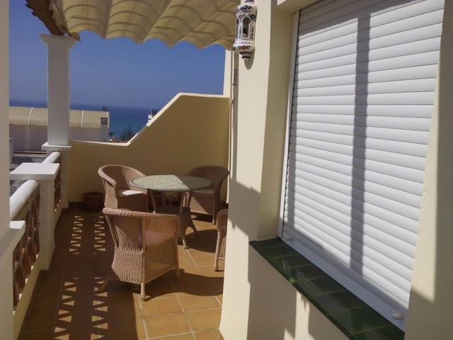 Penthouse apartment located in Torrox Costa just 500m from the beach.  Distributed over two bedrooms, Spain